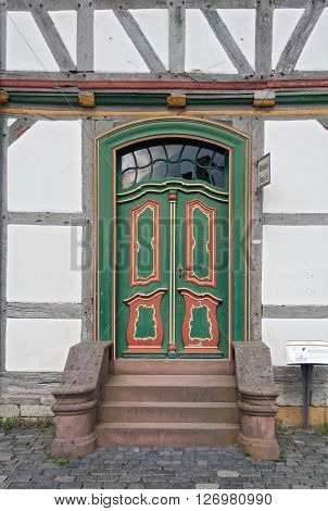 NEU ANSPACH, GERMANY - APRIL 18, 2016: wooden door in a half timbered house