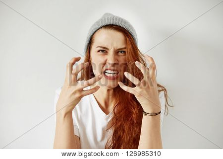 Close Up Isolated Portrait Of Young Annoyed Angry Woman Holding Hands In Furious Gesture. Young Fema