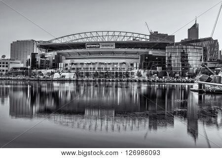 Melbourne Australia - Feb 21 2016: Etihad Stadium viewed from Docklands waterfront in early morning light. Black and white image.