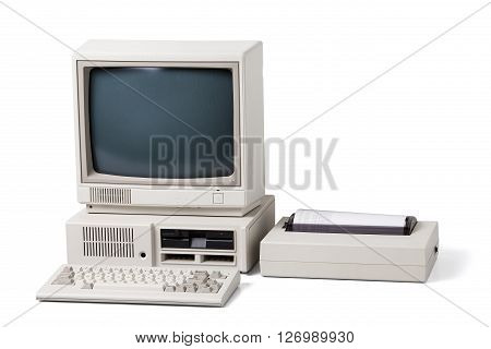 Old personal computer. The system unit monitor printer and keyboard isolated on white background.