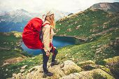 Young Woman with red backpack mountaineering Travel Lifestyle concept lake and mountains landscape on background vacations adventure journey outdoor poster