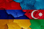flags of Armenia and Azerbaijan painted on cracked wall poster
