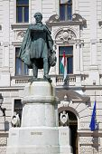 Statue of Lajos Kossuth and governmental building in Pecs Hungary. poster