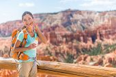 Hiker sunscreen. Woman hiking putting sunblock lotion outdoors during summer hike holidays. Mixed race Caucasian Asian female model. Bryce Canyon National Park, Utah, United States. poster