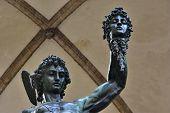 Bronze statue of Perseus holding the head of Medusa in Piazza della Signoria square (Florence) made by famous artist Benvenuto Cellini in 1545 poster