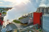 Beautiful sunset over the modern biofuel factory poster