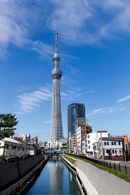 Tokyo, Japan - September 26 : Tokyo Skytree and a river under a blue sunny sky. September 26, 2014 in Tokyo, Japan. The Tokyo Skytree , A new television broadcasting tower and landmark of Tokyo