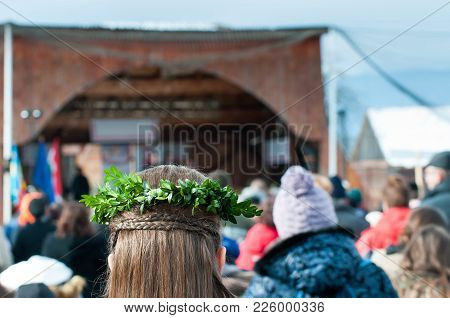 Green Leaves On Young Girls Hair Tress At The Carnival In Transylvania.