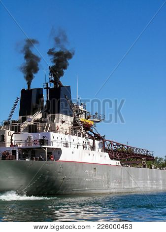 Black Smoke Rising From Smokestack On Shipping Freighter