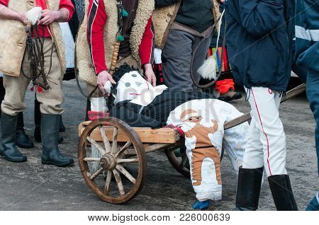 Traditional Winter Ending Carnival In Romania.  At The End  The Doll Will Be Burned, Symbolising  Th