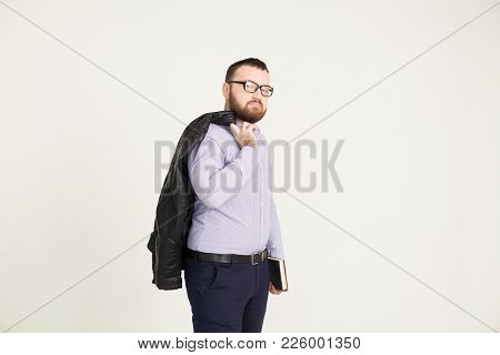 A Man In Business Attire On A White Background 1