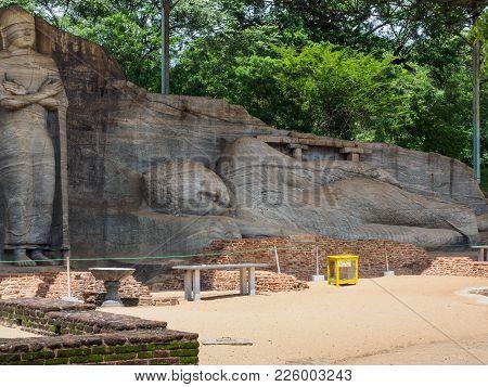 The Ancient Reclining Buddha Image And The Standing Buddha Image At Gal Vihara, Polonnaruwa, Sri Lan