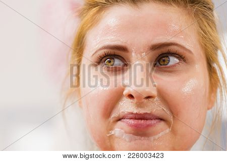 Facial Dry Skin And Body Care, Complexion Treatment At Home Concept. Happy Young Woman Having Dried
