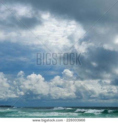 Dramatic Cloudscape With Heavy Rain And Tropical Storm At The Horizon On The Coastline Of Sri Lanka.