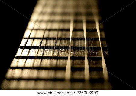 Concert Music Instrument Guitar Strings In Golden Musician Style. Closeup Of The String Instrument F