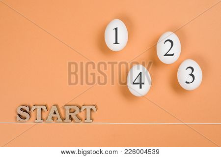 Abstract Image. The Word Start And Eggs On The Way From Start To Finish.