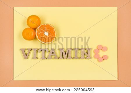 Word Vitamin C Is Written In Wooden Letters. Background Yellow, Vitamin C, Citrus.