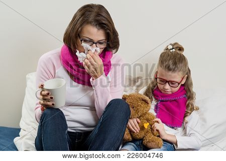Flu Season, Sick Mother And Child At Home.