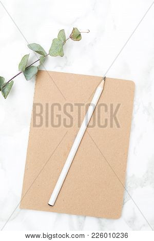 Notebook From Recycled Paper And A Pencil On A Marble Background. Vertical