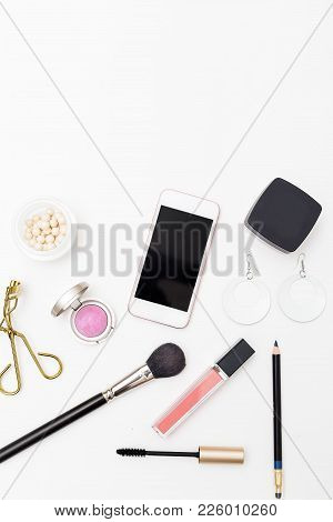 Cosmetics On White Background And Accessories. Vertical Copy Space