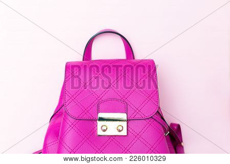 Bright Pink Female Backpack On A Pink Background. Copy Space