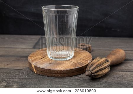 Wooden Juicer On A Dark Wooden Table With Chopping Board And Empty Glasses. Space For Montage Produc
