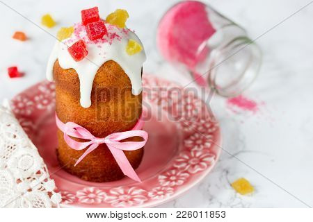 Easter Cake Kulich Or Paska Decorated White Frosting, Pink Sugar And Candied Fruit