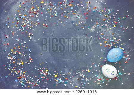 Easter Background With Painted Eggs And Colorful Crushed Eggshell Frame