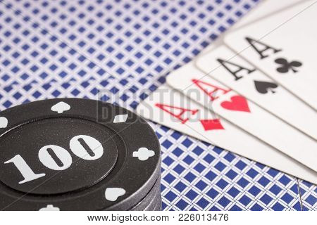 Poker Chips And A Combination Of Four Aces Concept Of A Gambling Board Game