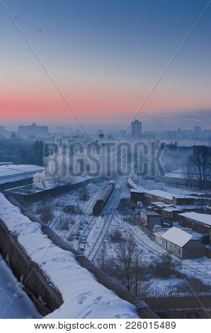 The Railway In The City. Industrial Quarter In A Big City. Sunrise. Vertical Shot.