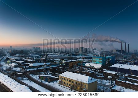 Many Buildings And Factories. A Working Thermal Power Plant. Central Heating. Industrial Smoke.