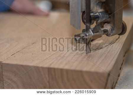 Joiner Cuts Thick Wood With A Band Saw - Close-up