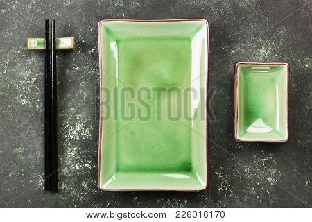 Traditional Ware For Asian Food On A Green Background. Top View. Food Background