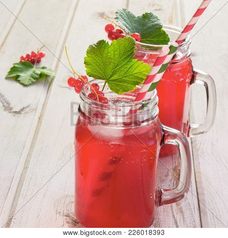 Homemade Red Currant Lemonade In A Mason Jar With Decor Of Berry On Ligth Wooden Table. Close Up.