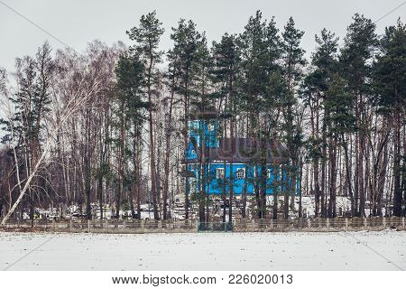 Pawly, Poland - January 26, 2018: St John The Theologian Wooden Orthodox Church And Cemetery In Pawl