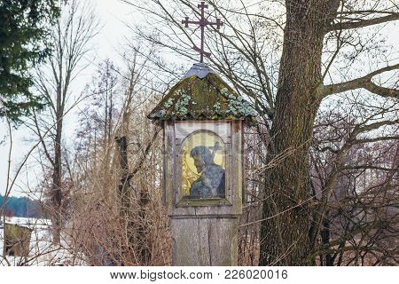 Soce, Poland - January 26, 2018: Wooden Pole Chapel In Soce Village In Podlasie Region Of Poland