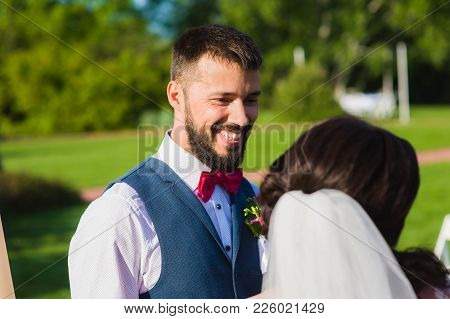 First Exciting Meeting And Look Of Man And Woman During Their Wedding Ceremony Outdoors