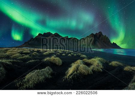 Iceland Night Landscape Amazing Northern Light In Vestrahorn Mountain With Black Sand Dunes At Stokk