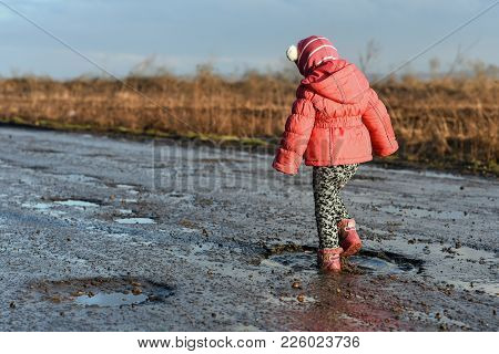Little Girl Plays In Puddle, Children's Fun, Unforgettable Moments, Dirty And Wet Shoes, Fun With Fa