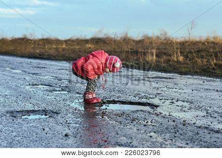 Little Girl Looking Into Puddle, Children, Unforgettable Moments, Fun With Father, Life In Village.