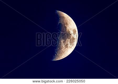 Close Detail Shot Of The Crescent Half Moon In The Clear Night Sky