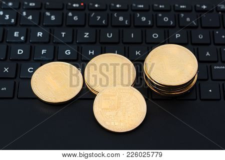 Bitcoins On Keyboard Of A Laptop Computer