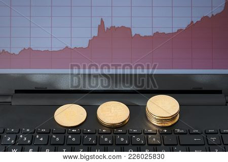 Blockchain Concept : Rise Of Bitcoin Price. Laptop Computer Screen Showing Increasing Price Graph Wi