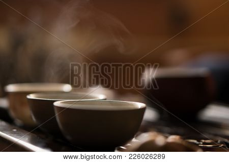 Exquisite Green Tea In Vial At Traditional Chinese Tea Ceremony. Set Of Equipment For Drinking Tea.
