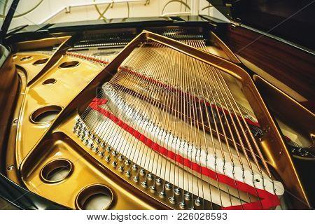 Mechanism Of Piano Inside, Closeup. Piano Strings