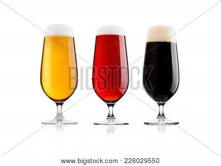 Cold Glasses Of Lager Stout And Red Beer With Foam And Dew On White Background With Reflection