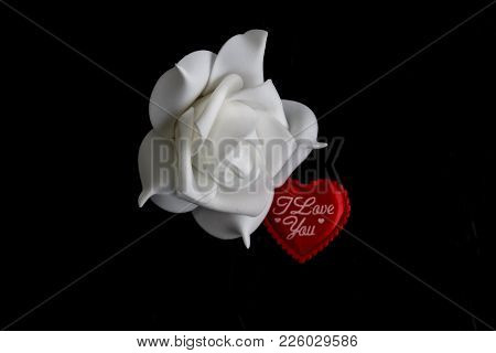 Heart I Love You To The Day Of The Holy Valentine On A Black Background Next To A White Rose In Blur