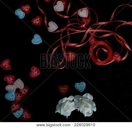 Hearts I Love You To The Day Of The Holy Valentine On A Black Background Next To A White Rose In Blu