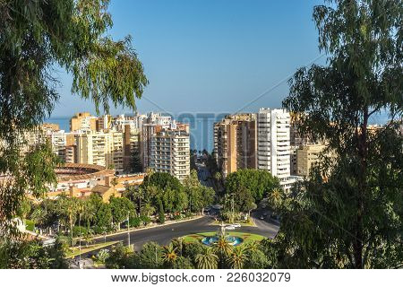 City Skyline Of Malaga Overlooking The Sea Ocean In Malaga, Spain, Europe On A Bright Summer Day