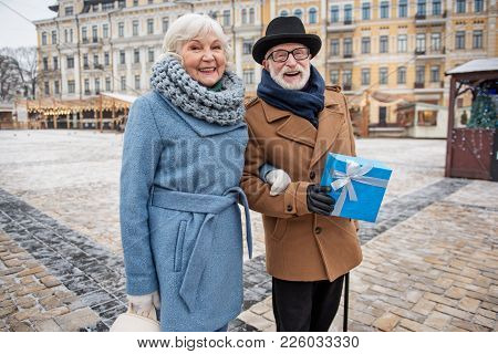 Portrait Of Happy Mature Man And Woman Enjoying Time Together On Holiday. They Are Looking At Camera